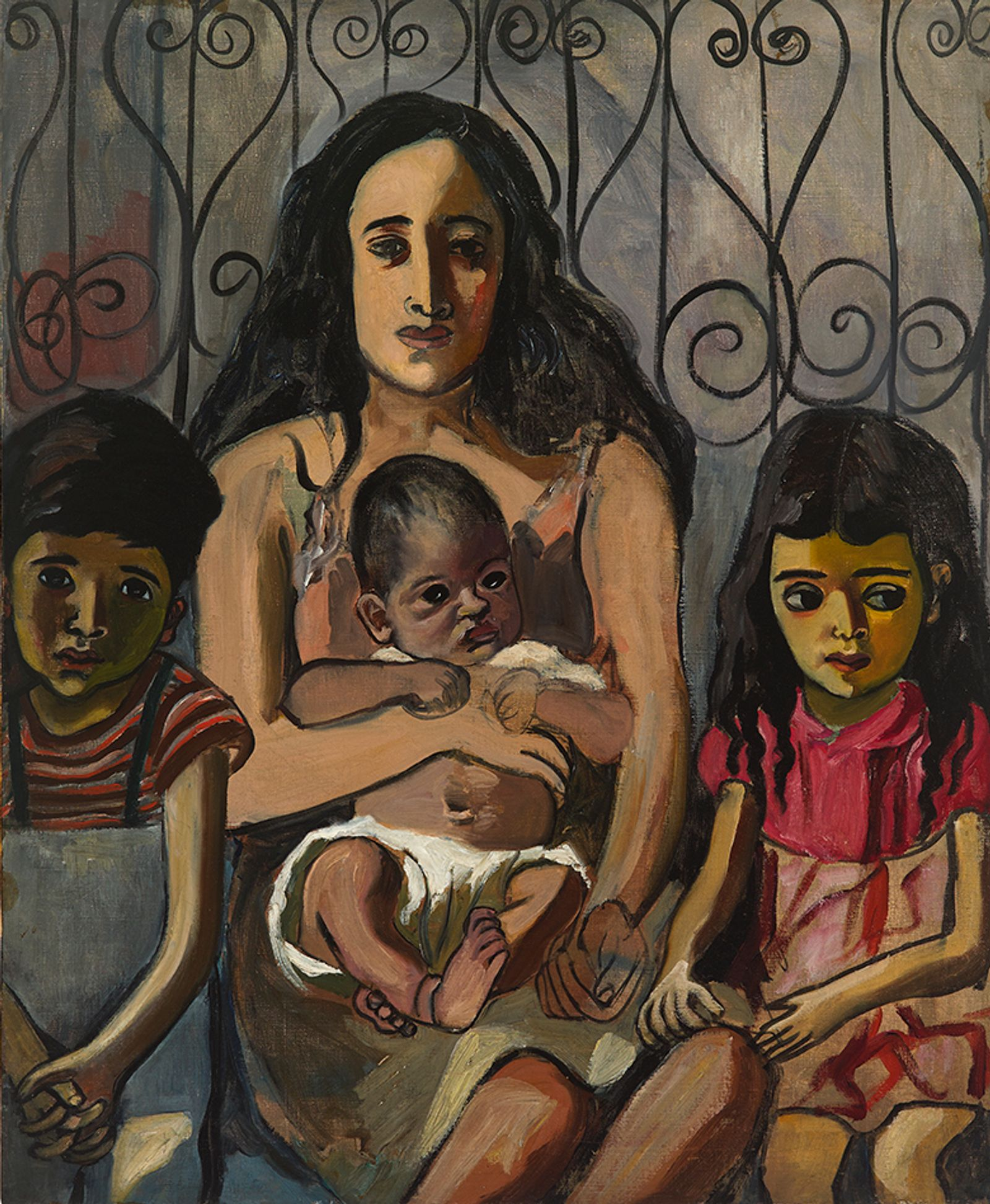 A woman holds a baby flanked by two small kids.