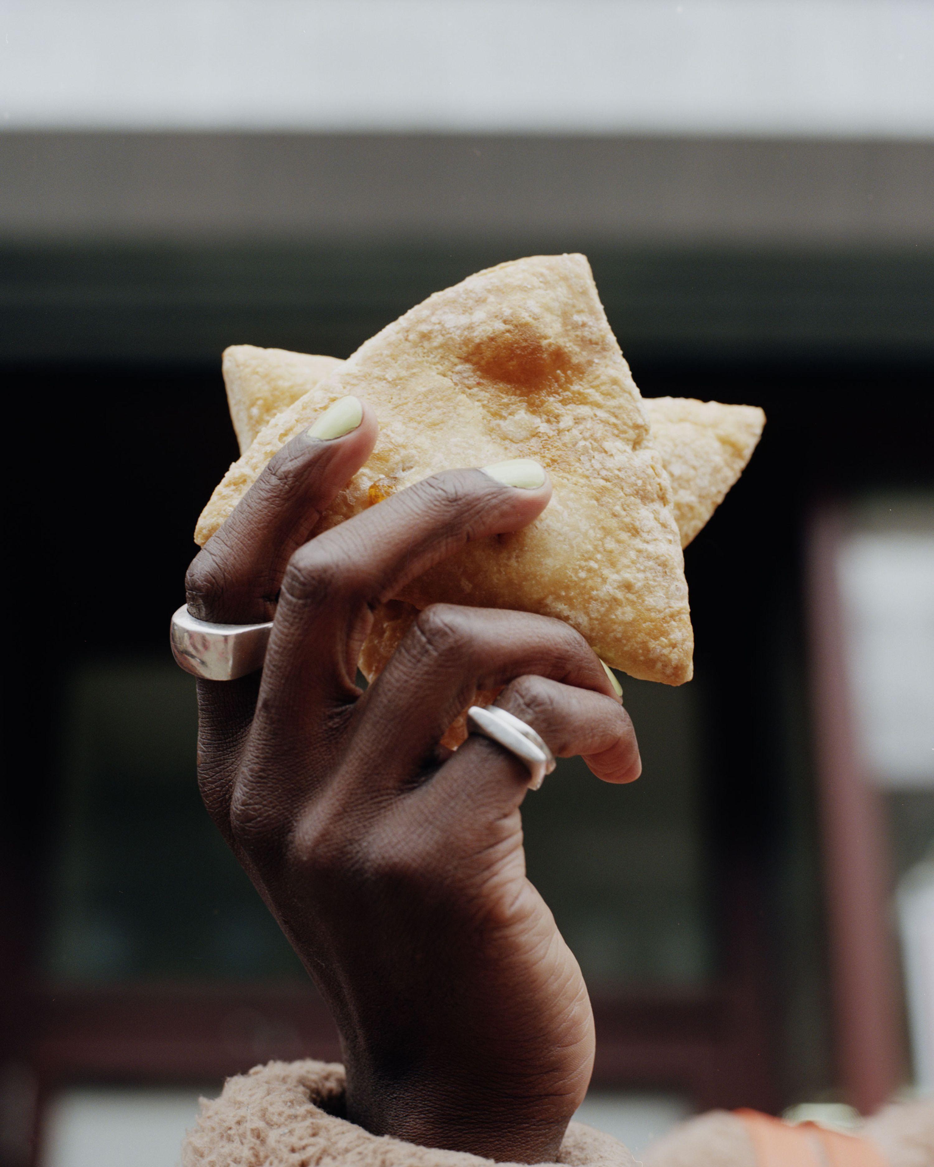 Pastries in Devonn Francis' hand.