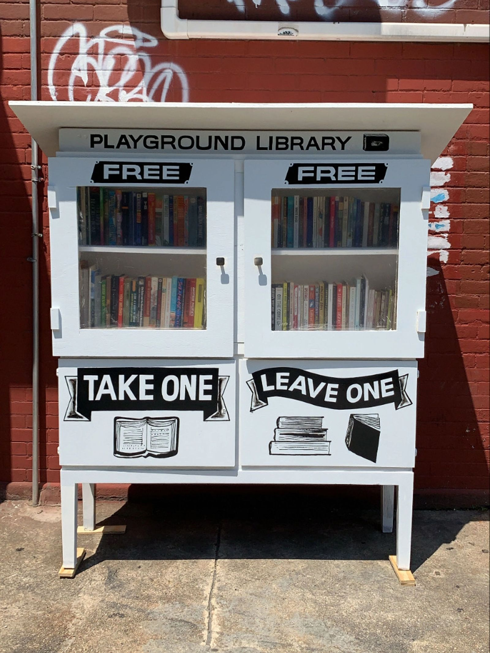 Take One Leave Library outside of Playground Coffee Shop.