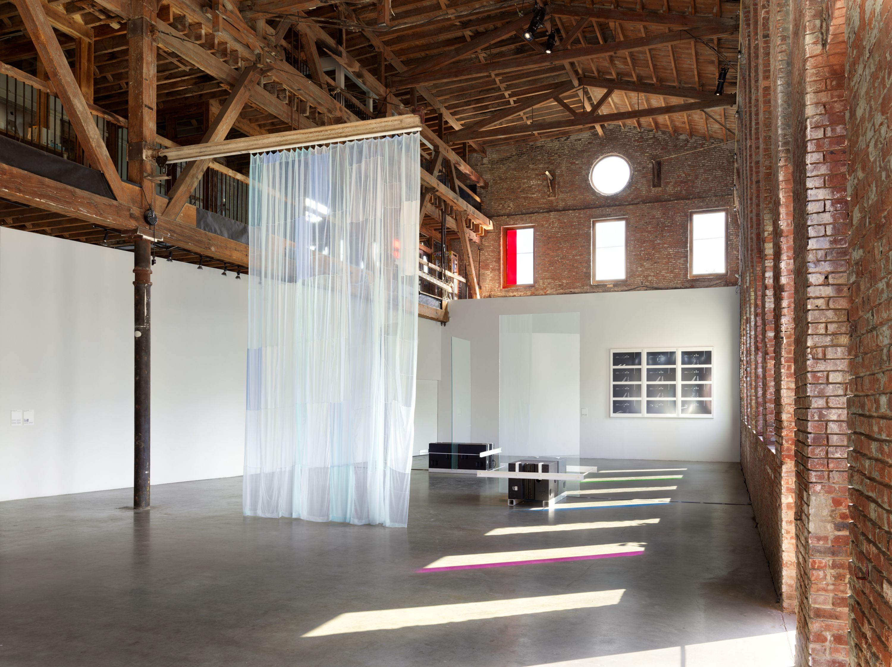 High-ceilinged architectural space inside Pioneer Works where CLOCKWORK is located.