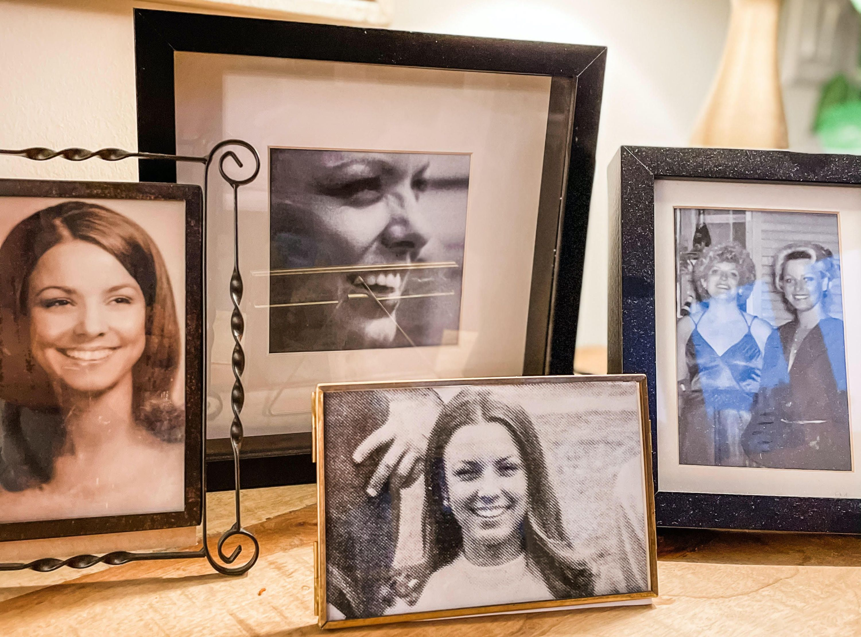 """""""This is my sideboard that I set up with pictures of my mom after she died. These are my absolute favorite photos of her and they remind me of her spirit before she ever got sick. My entire year was consumed with my grief about losing her. I remember."""" — Jesse Danville"""
