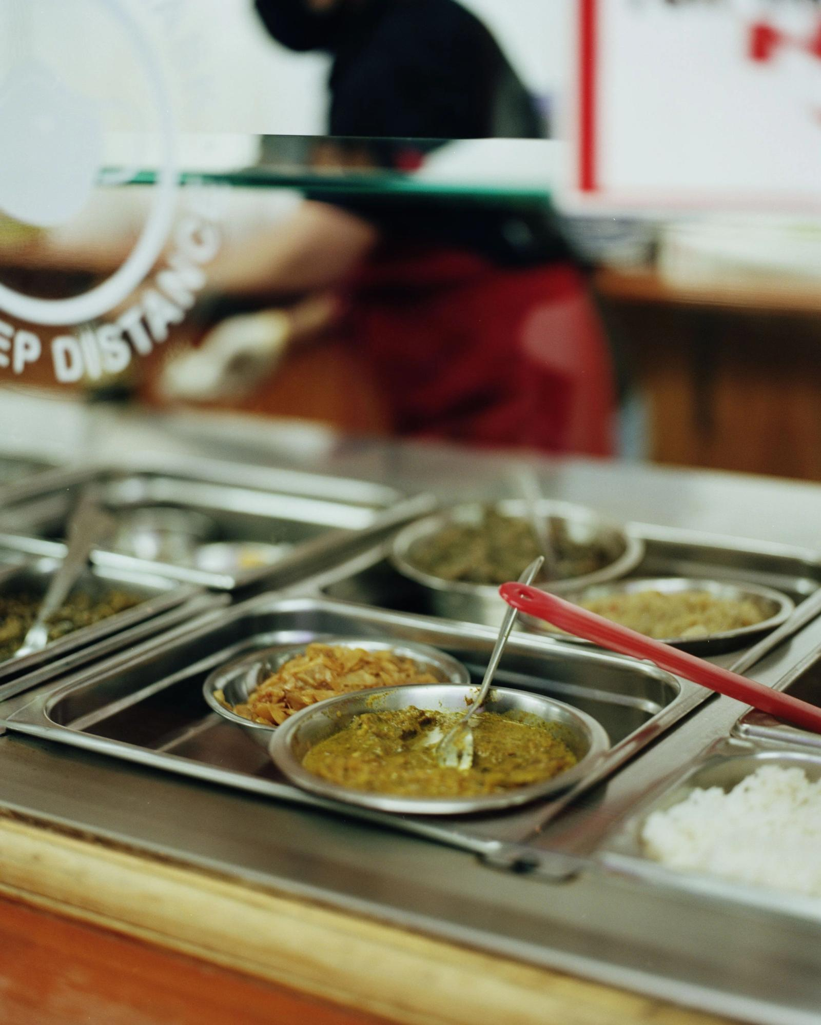 Various curries in serving dishes.