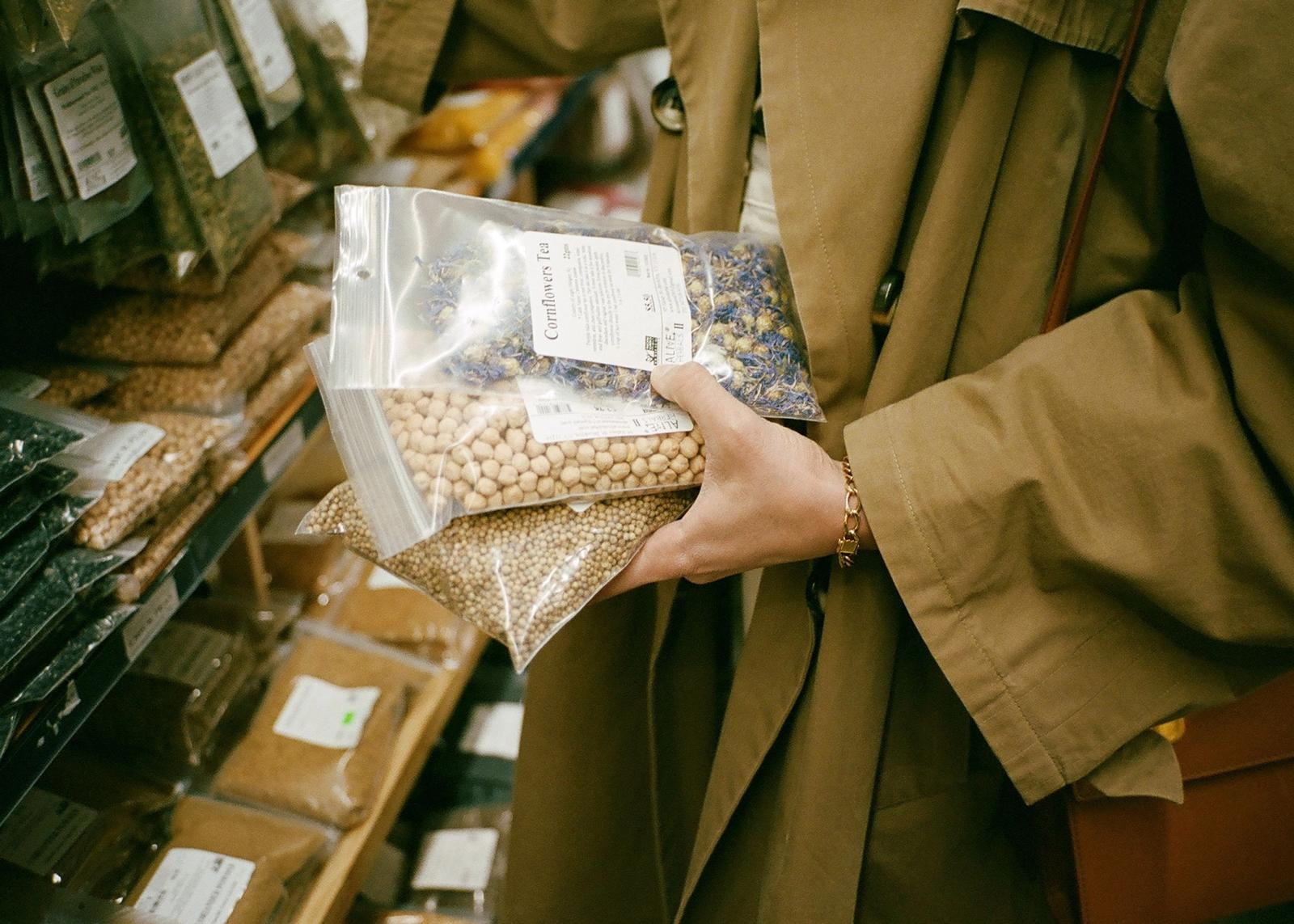 hand holding bags of dried beans and spices
