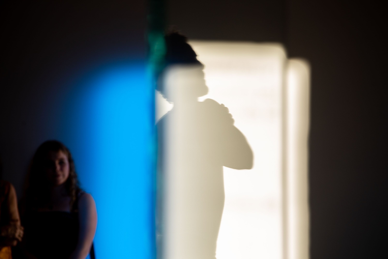 Audience member watching performance of Gerard & Kelly, Clockwork (2018).