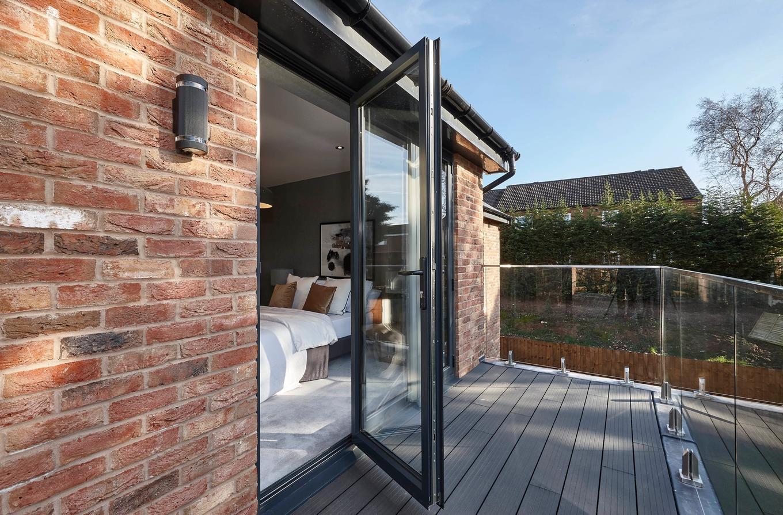 Aluminiu BiFold Doors leading to a garden pation