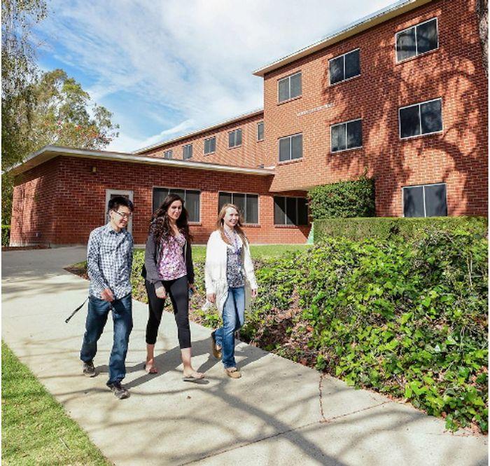 Students Walking Outside of Dorm
