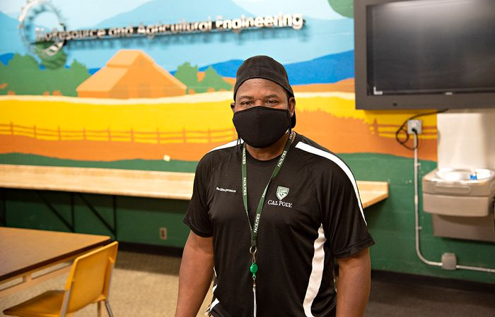 Jerry White custodian smiling behind a mask