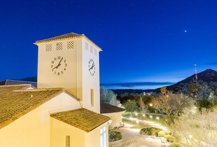 The clock tower at the Orfalea College of Business at dusk on the campus of Cal Poly in San Luis Obispo, Ca.