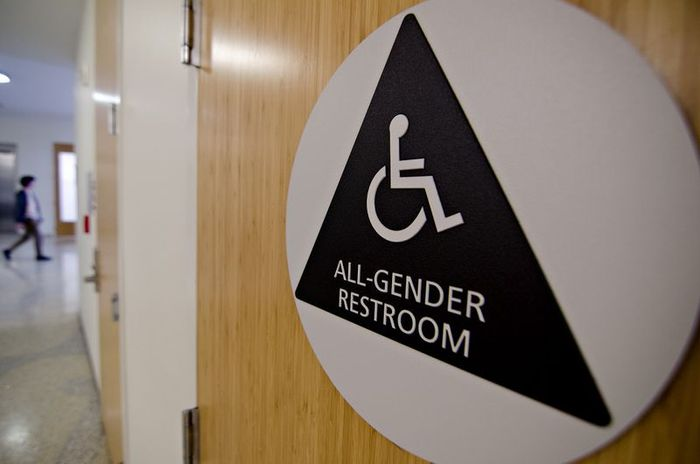 New all-gender restroom signage on the first floor of the Baker Science Building.