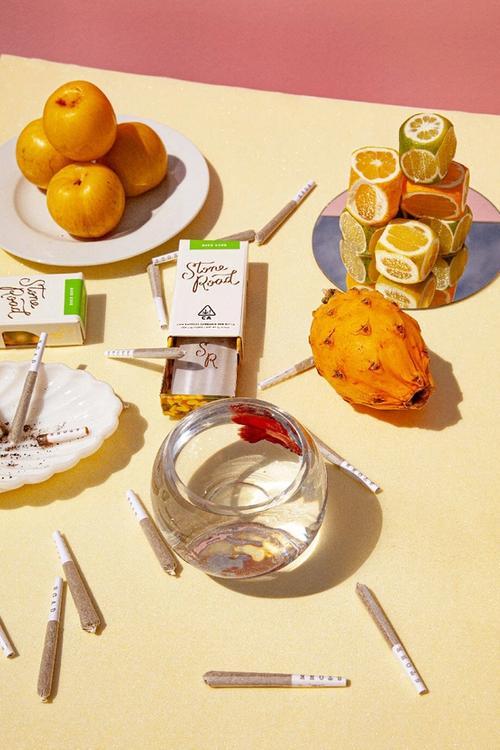 marijuana and fruits on table