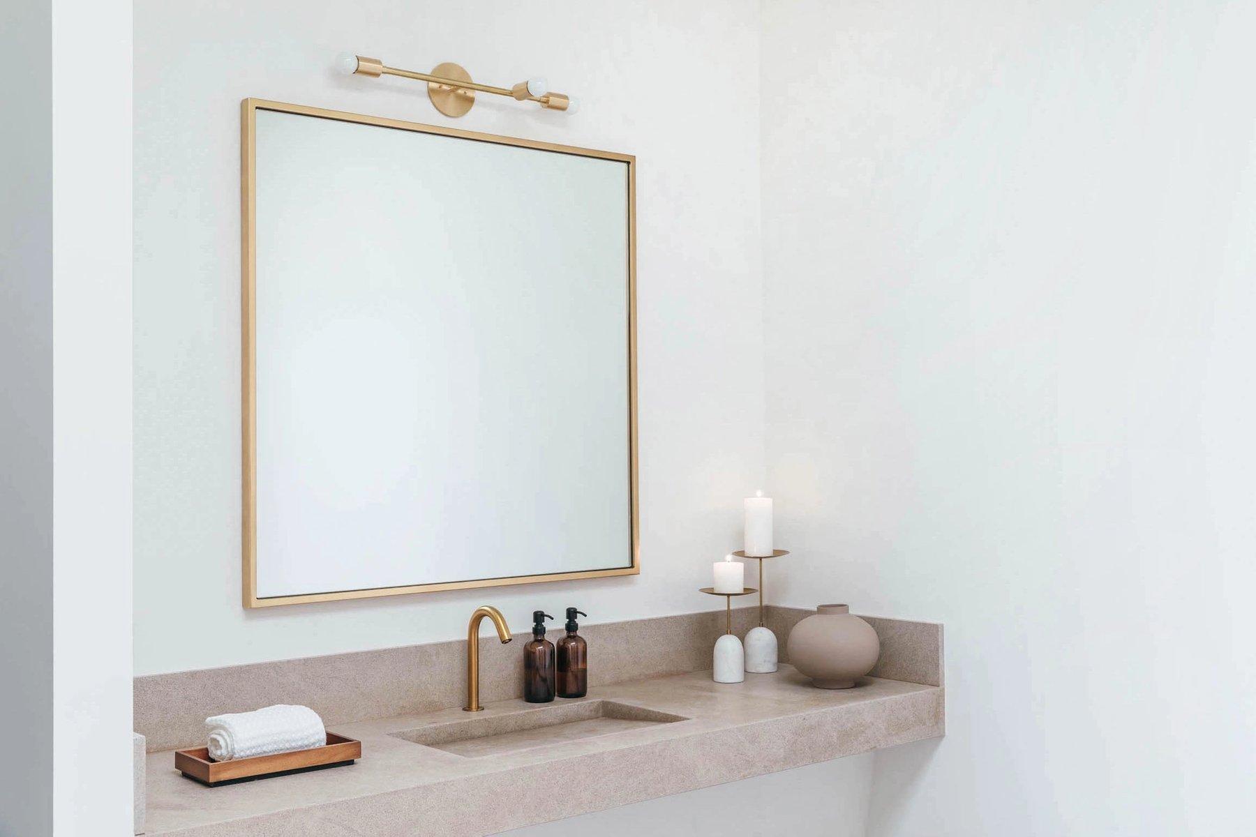 Custom limestone vanity with concealed drain