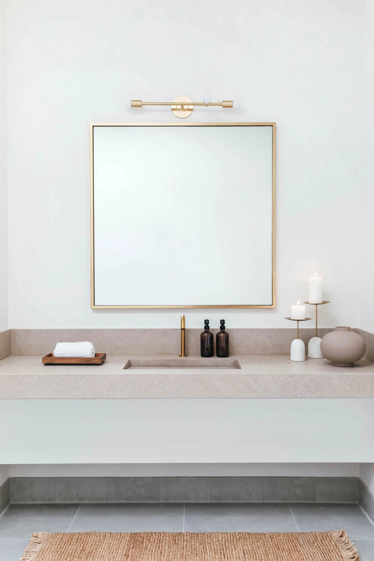 Limestone vanity. Light by Park Studio.