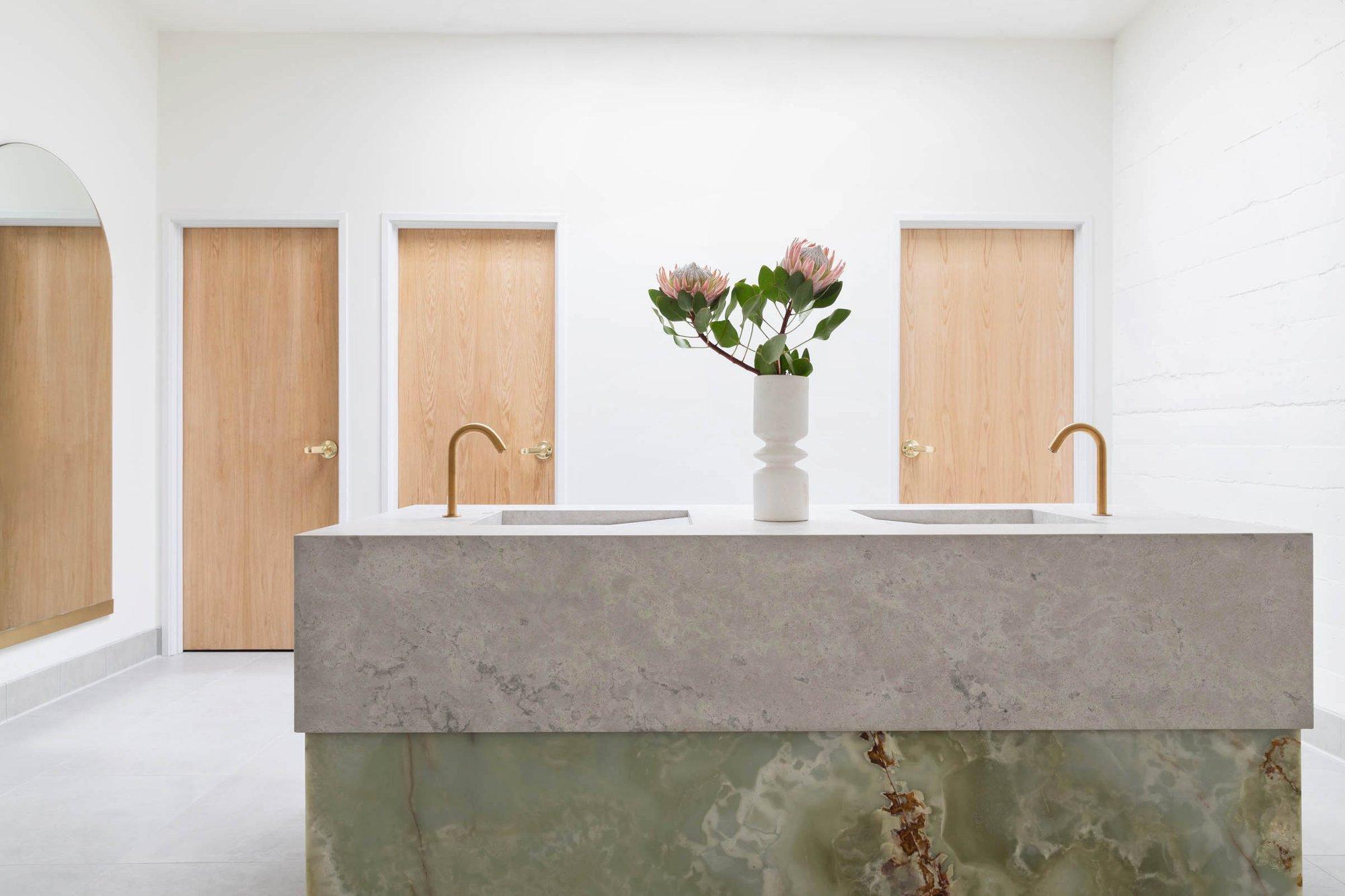 Custom onyx and limestone vanity