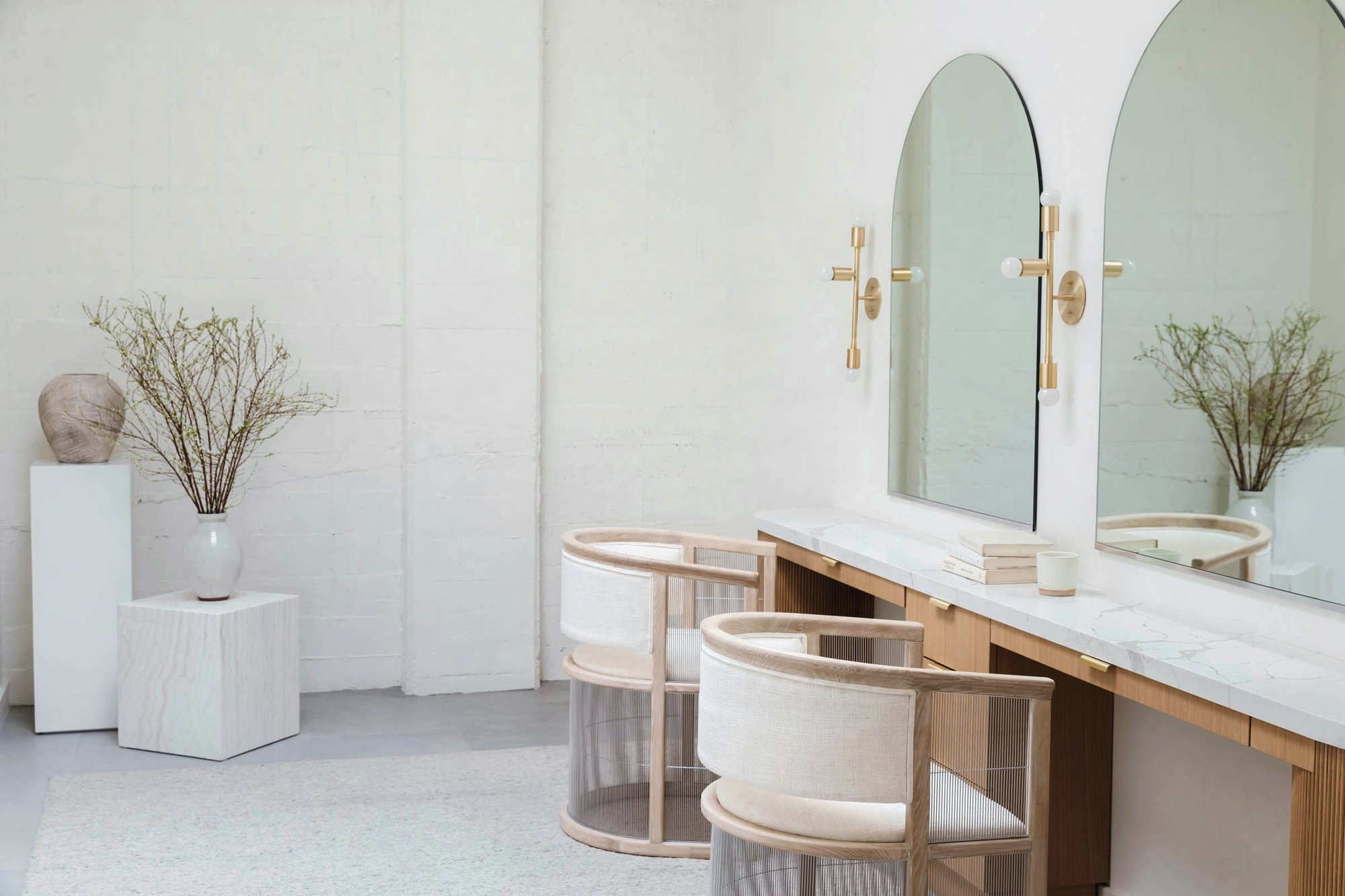 Dressing room featuring custom designed vanity and mirrors