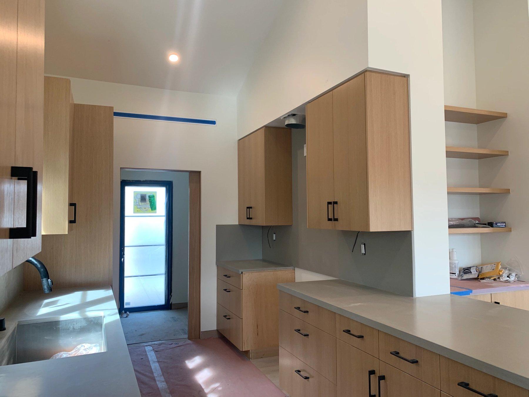 White oak kitchen cabinets and quartz counters