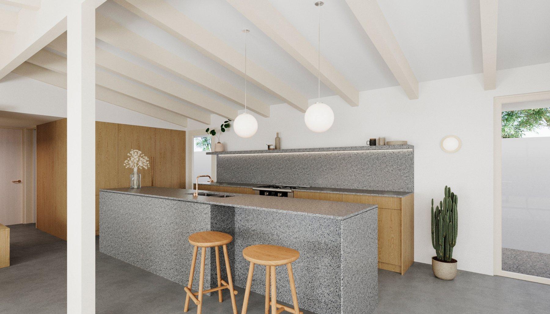 A granite kitchen island and seamless backsplash