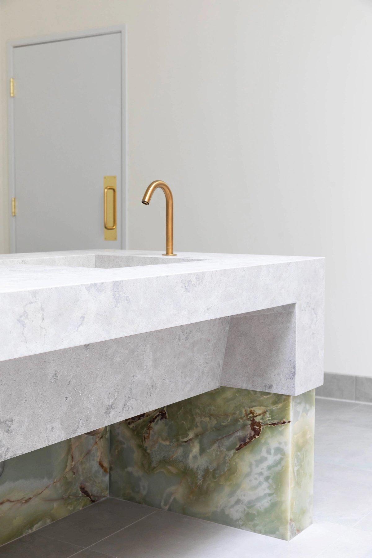 Onyx, brass & limestone details.