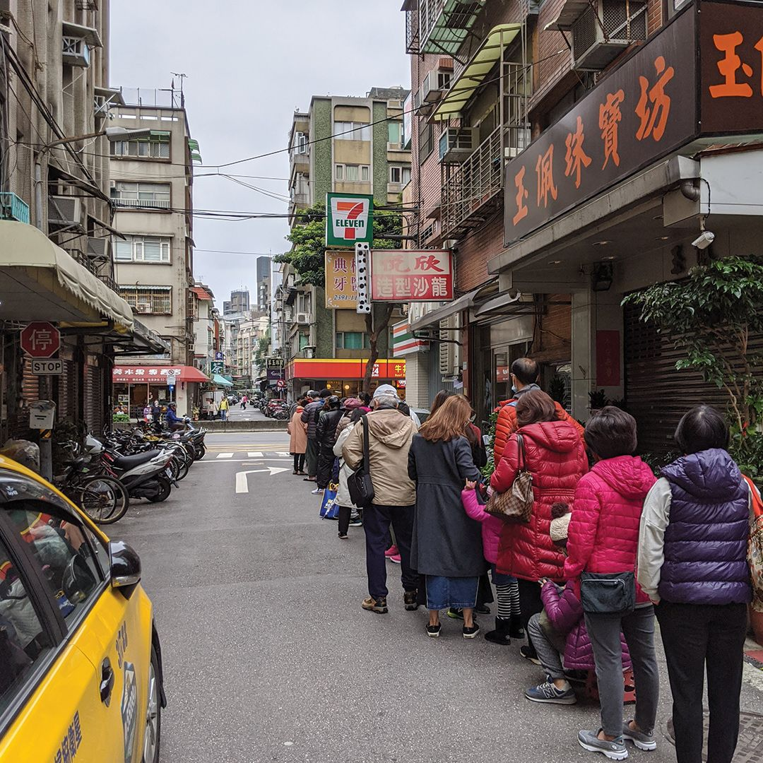 Line outside a pharmacy in Taiwan. People waiting to buy surgical masks.