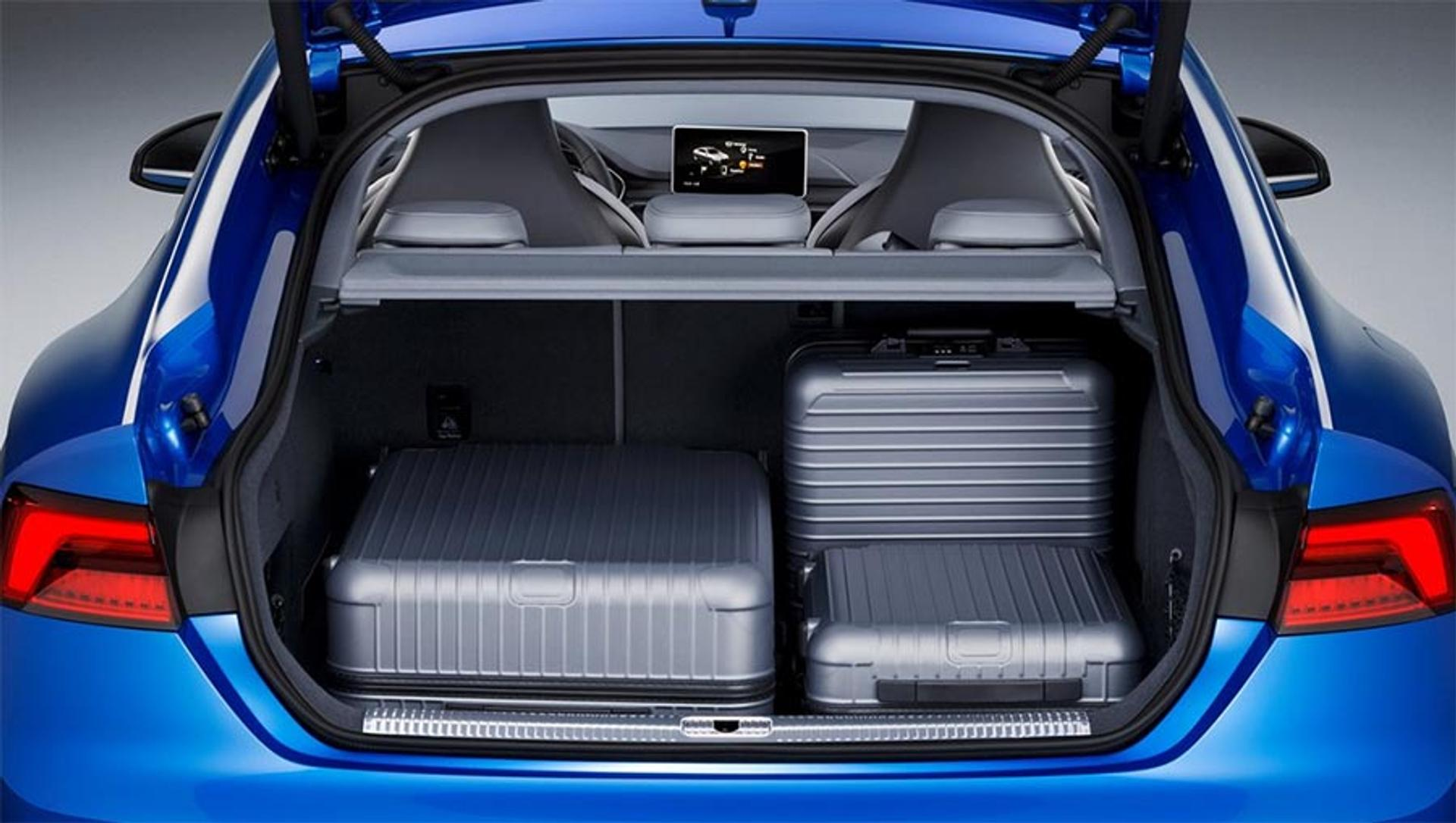 Audi S5 trunk with suitcases packed inside