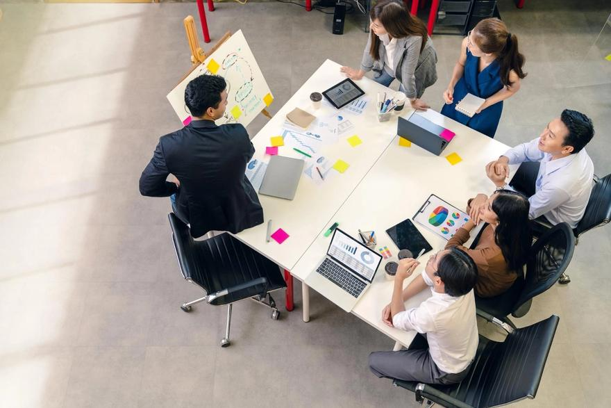 Product roadmap: Group of employees brainstorming during a meeting