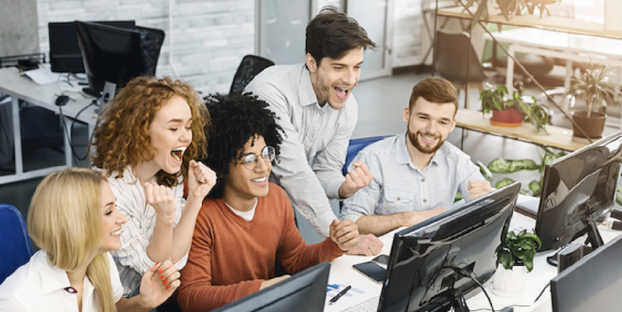 agile estimation: people celebrating success while looking at a computer