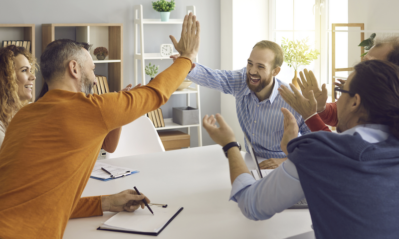 release plan: team clapping hands and giving high fives