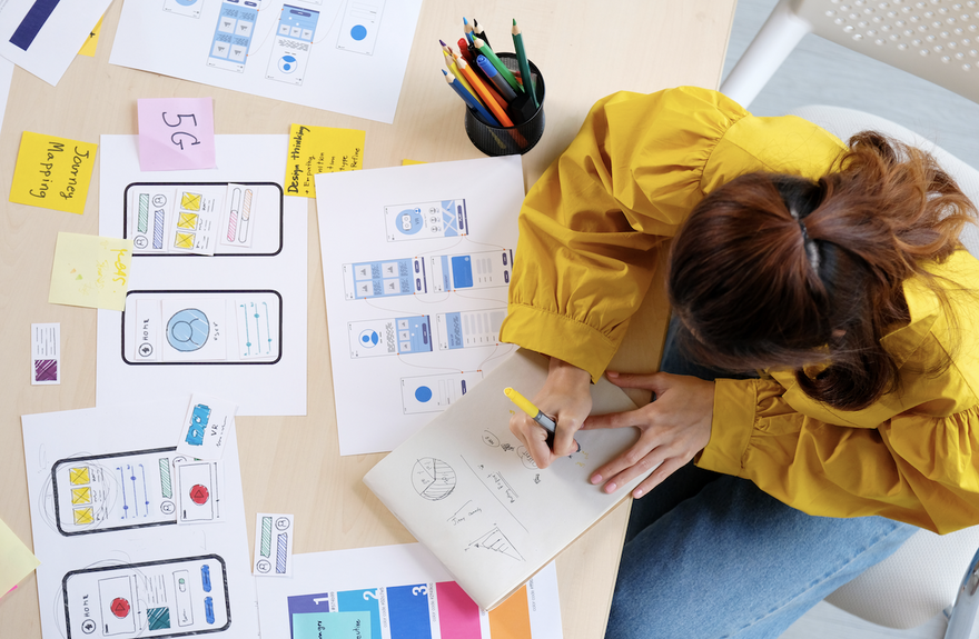use cases vs user stories: woman drawing on a notepad