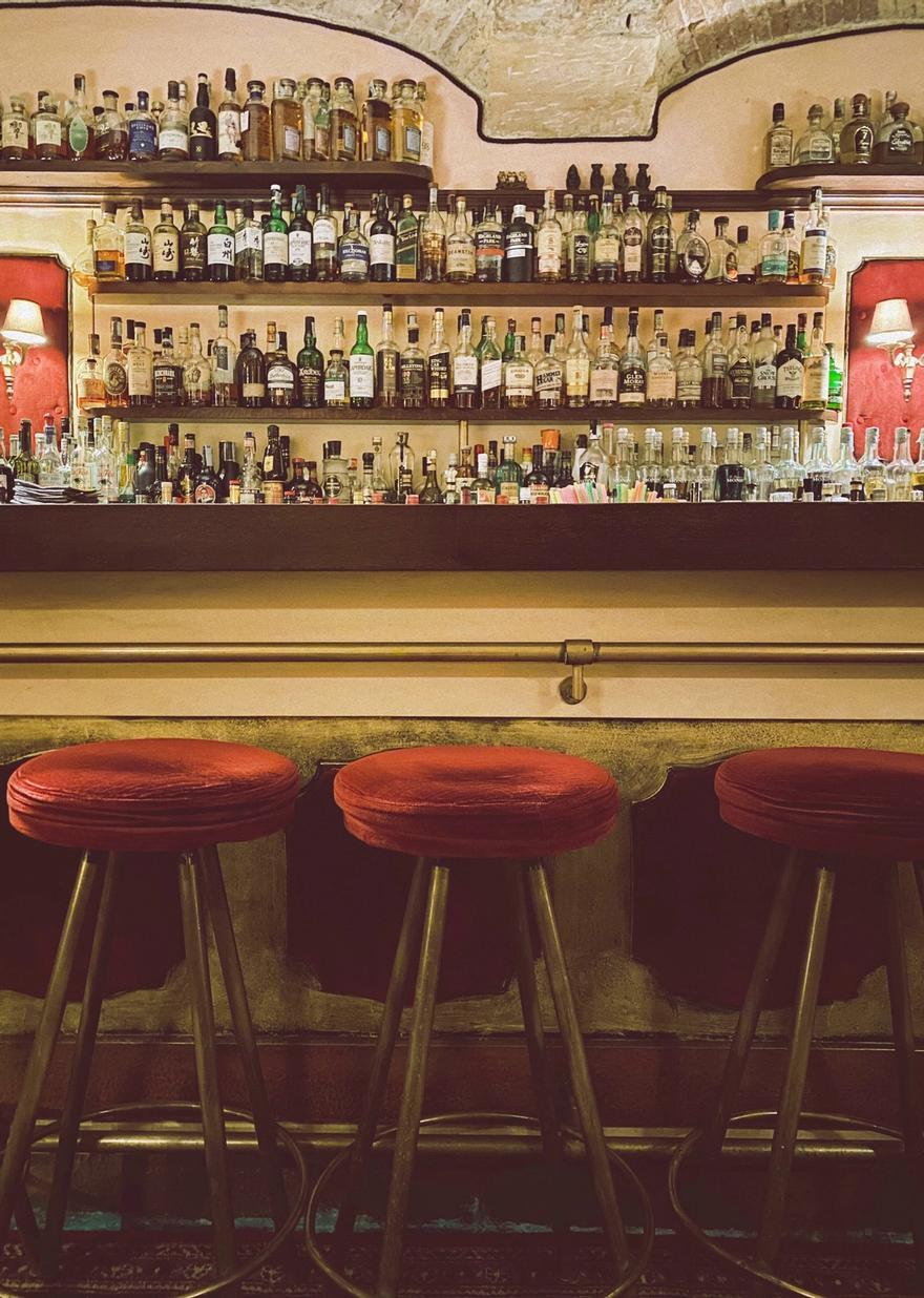 Three stools at a bar