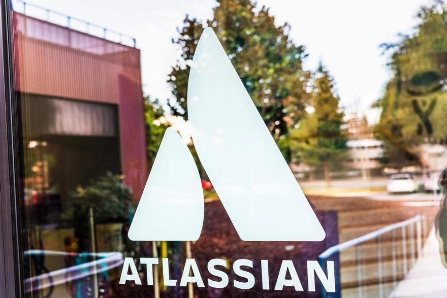 Jira tutorial: Atlassian logo and their office at the background