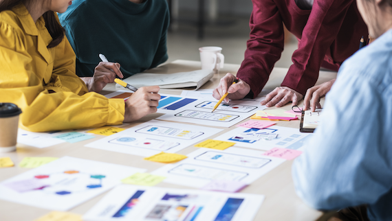 User segmentation: Group of employees brainstorming