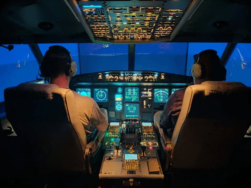Image of two pilots in cockpit
