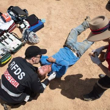 Image of Royal Flying Doctor Service helping injured man in Outback NSW