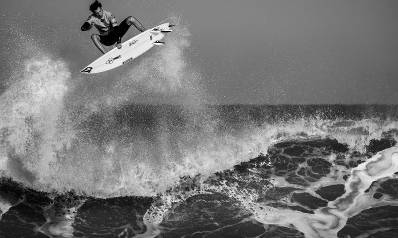 Man doing an air on a surfboard