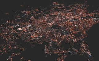 Satellite image at night with lights on