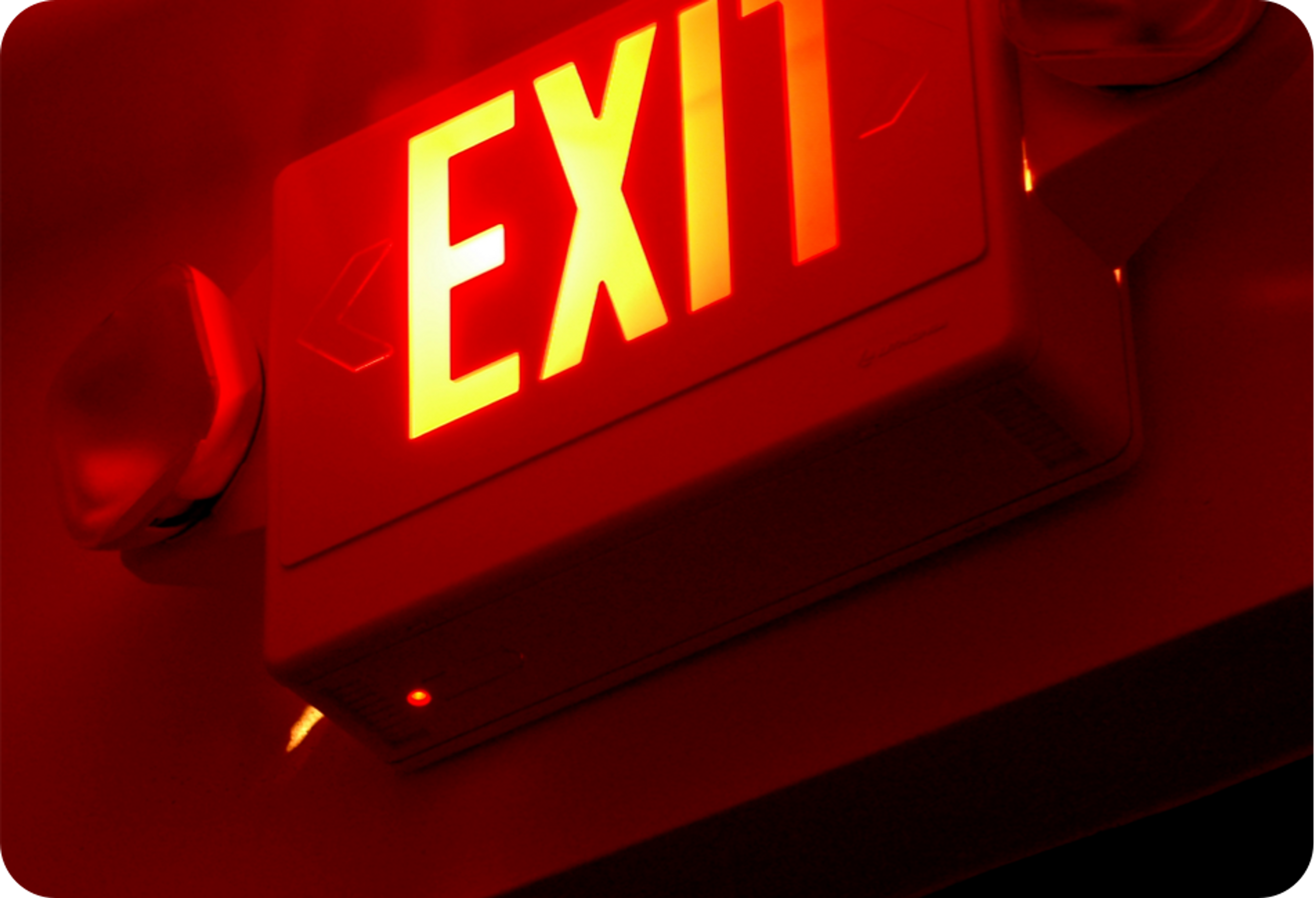 """Picture of """"EXIT"""" sign glowing red"""