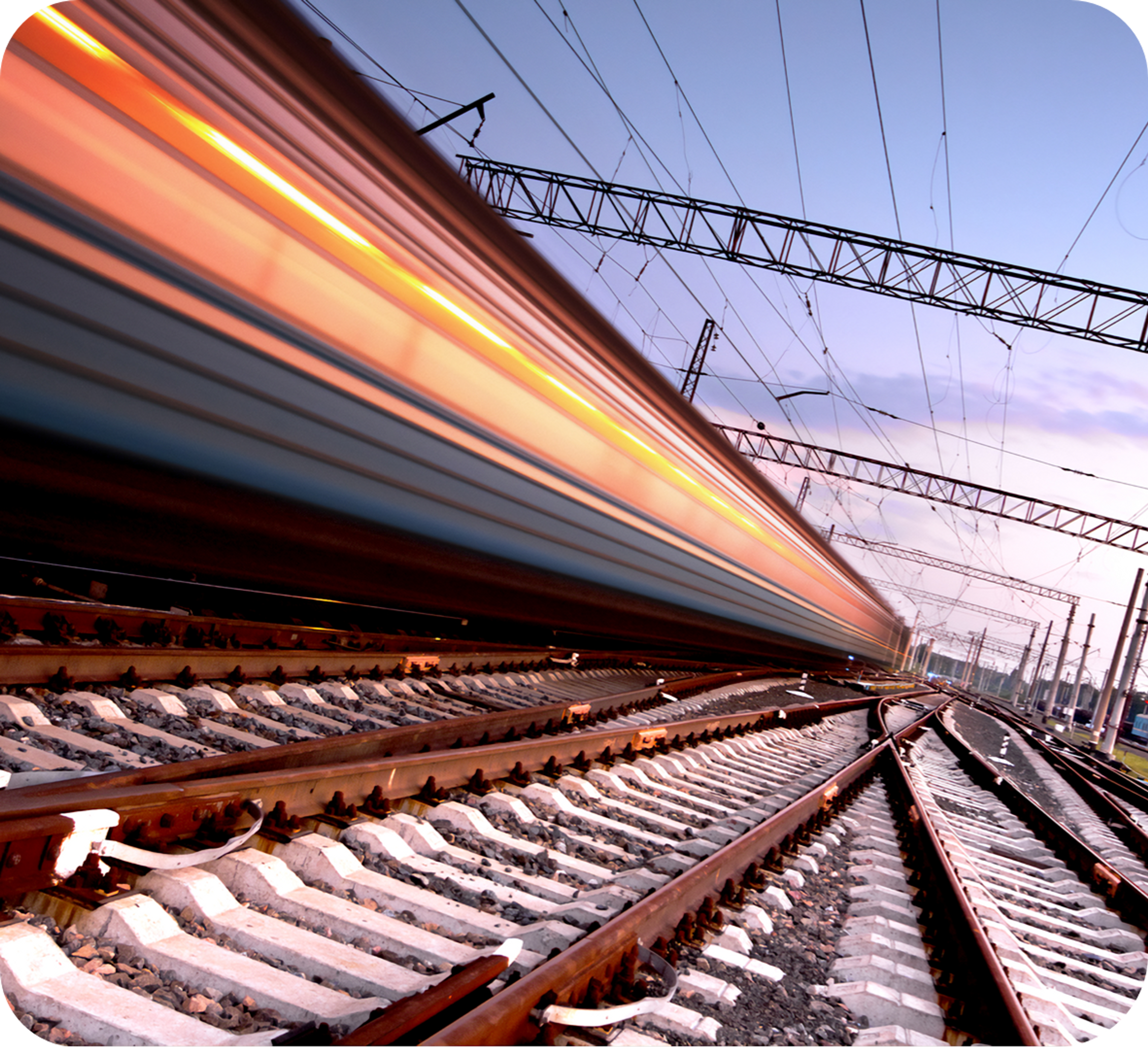 Picture of a fast moving train on train tracks