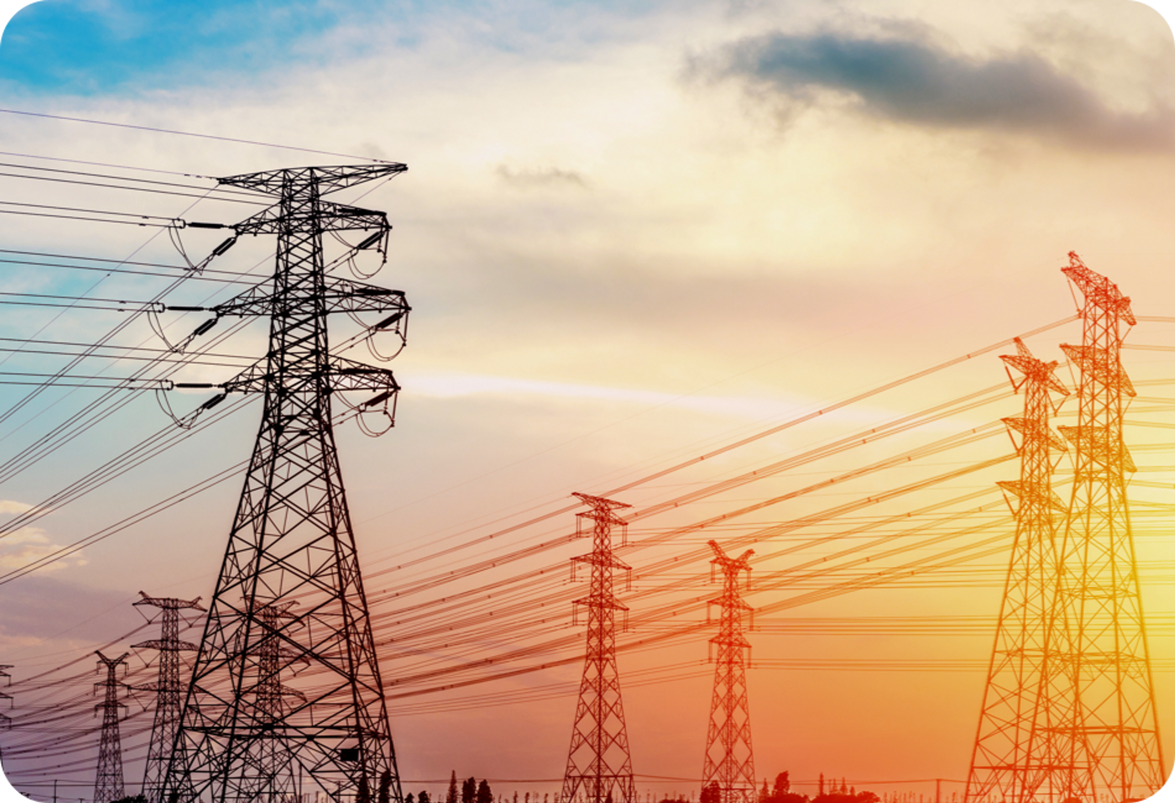Picture of eight electrical towers against a sunset horizon