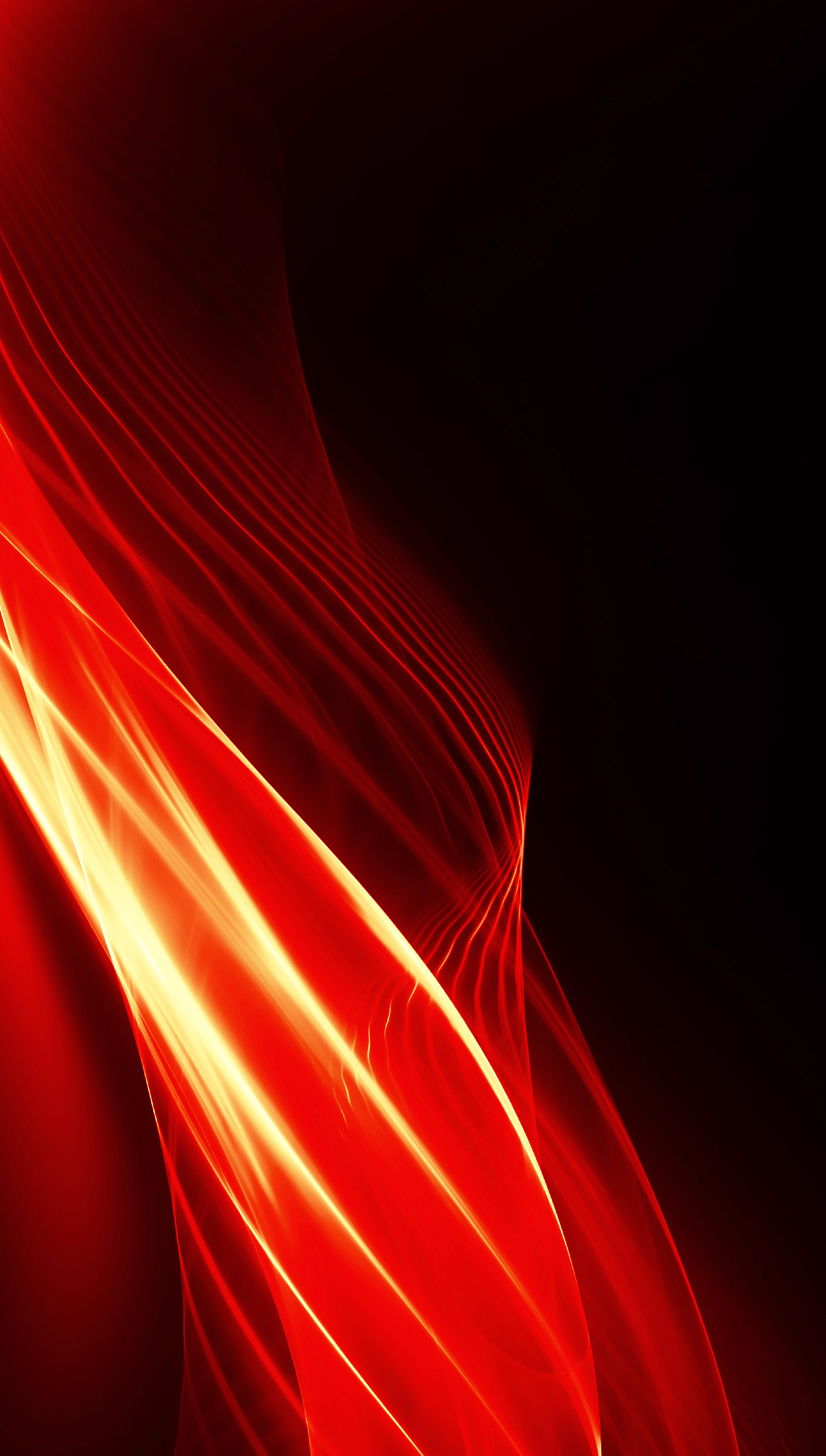 Black background image with red, orange and white light flares