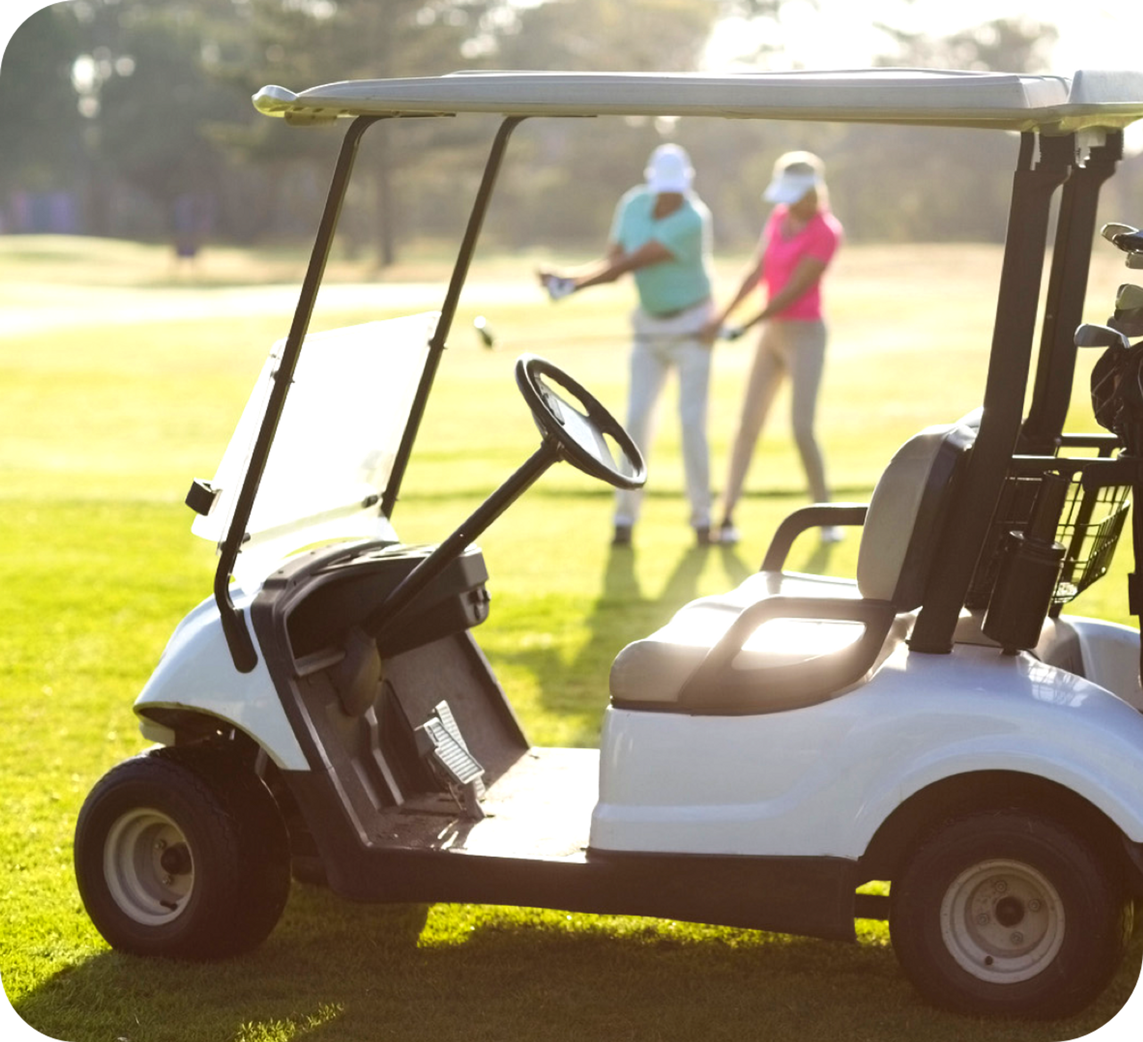 Picture of a white golf cart with a female and male golfer in the image background