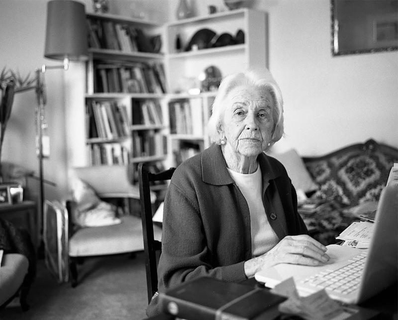 Margaret McDonald at her laptop in her lounge room