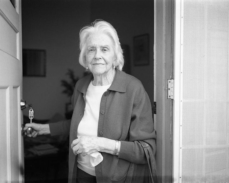 Grandmother opening door