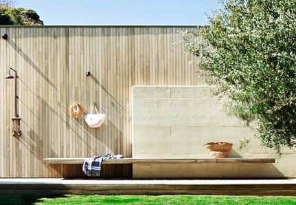 Outdoor shower with wooden battens and bench seat in Melbourne