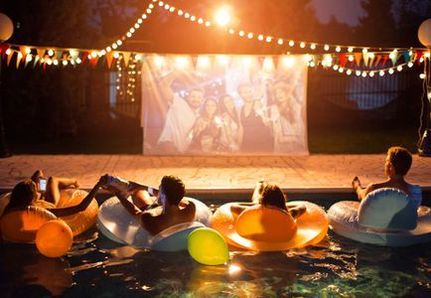 Dive in cinema at home, sitting on pool floats