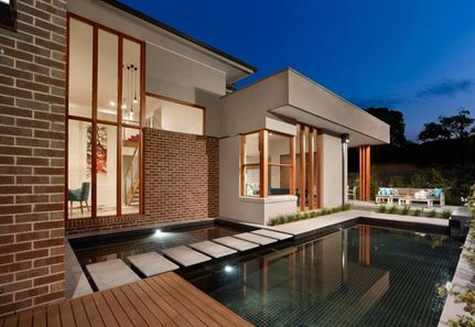 Pool spa and house with dining area landscape design in Camberwell Melbourne