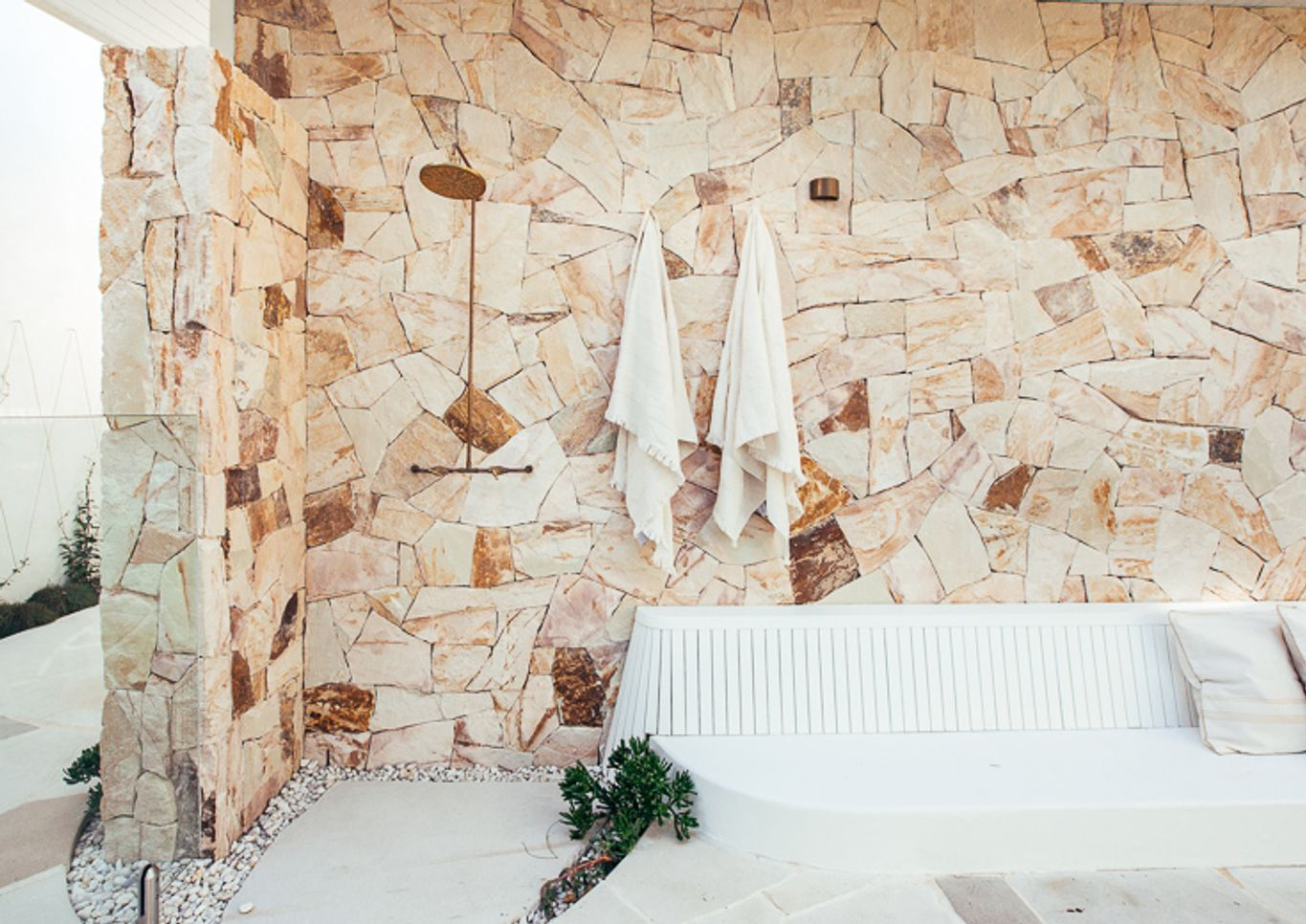Brass outdoor shower with stone cladding Strathmore
