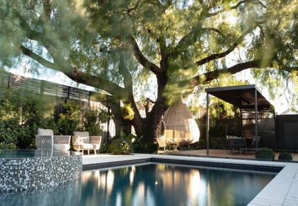 Pool and spa with seating areas landscape design Williamstown