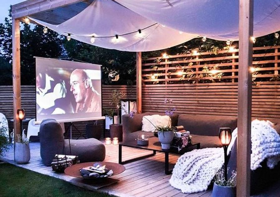 Garden patio cinema with lounges