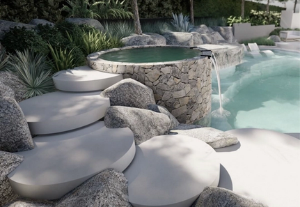 Pool with boulders and concrete steps