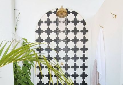 Outdoor shower black and white tile pattern