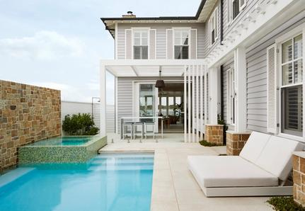 Pool and house with dining area and outdoor shower